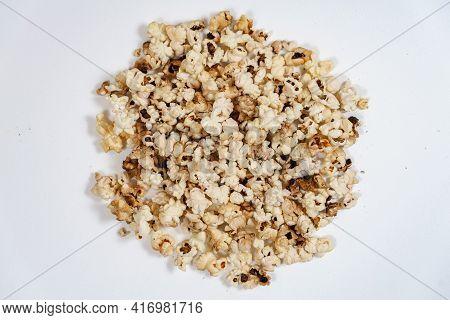 Spoiled Burnt Popcorn Grains On White Background