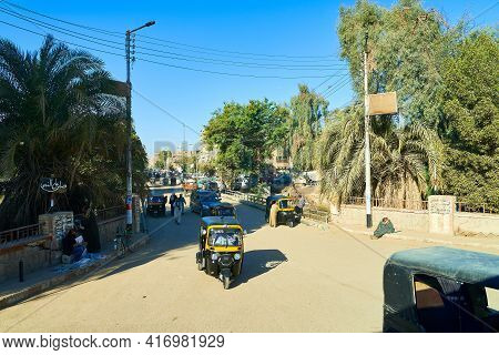 Qena, Egypt - January 30, 2021 - Ordinary Street Life In A Small Provincial Town. Taxi Tuk-tuk Rides
