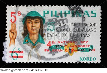 ZAGREB, CROATIA - SEPTEMBER 18, 2014: Stamp printed in Philippines issued on the occasion of the Philippine Girl Scouts, 25th anniversary, circa 1969