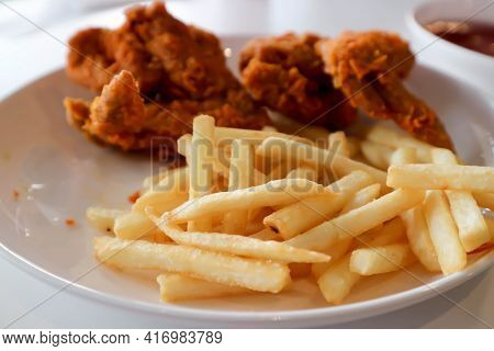 Fried Chicken, Deep Fried Chicken Or Chicken Wing And French Fries