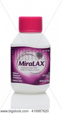 IRVINE, CA - JUNE 23, 2014: A 8 ounce bottle of MiraLax laxative. MiraLax is a polyethylene glycol powder for the treatment of occasional constipation manufactured by Merck.