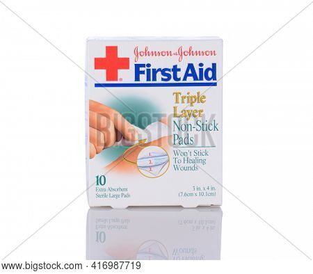 IRVINE, CA - January 05, 2014: A box of Johnson and Johnson First Aid Non-Stick Pads. A 10 count package of Triple Layer Sterile pads for wounds.