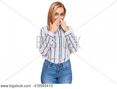 Beautiful caucasian woman wearing casual clothes laughing and embarrassed giggle covering mouth with hands, gossip and scandal concept