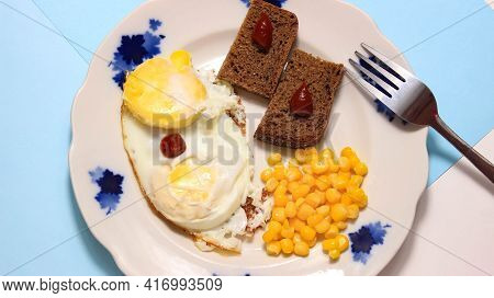 A Dish With Fried Egg, Corn And Bread On A Plate, Where All The Ingredients Gradually Appear. Top Vi