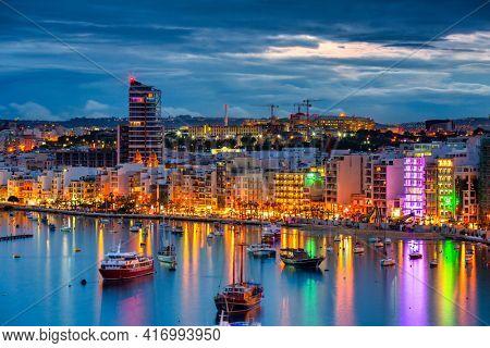 Valletta, Malta - January 11, 2019: Tourists boats in the harbor of Sliema on Malta at dusk.