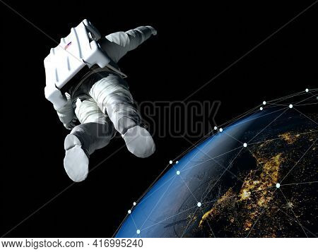 Astronaut flying over the planet.