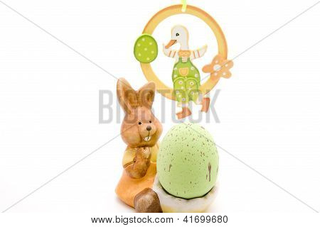 Easterbunny with Easteregg on white background