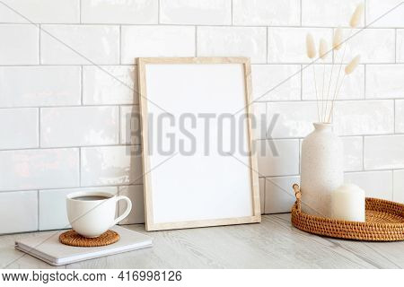 White Picture Frame Mockup And Home Decor On Table. Scandinavian Living Room Interior Design. Nordic