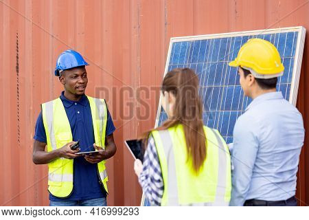 Outdoor Shot Of Black African Engineer Inspect Electrical Solar Panel Wearing Hardhat, Protective Ey