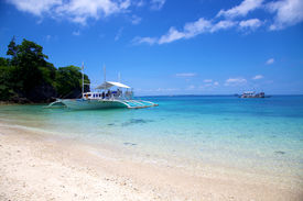 Banca Boat On White Sand Tropical Beach On Malapascua Island, Philippines