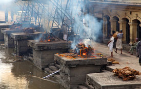 KATHMANDU NEPAL - NOVEMBER 7: Nepalese people burning corpses and then drown them in a river on