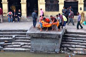 KATHMANDU NEPAL - NOVEMBER 7: Nepalese people preparing burial ceremony in Pashupatinath Temple