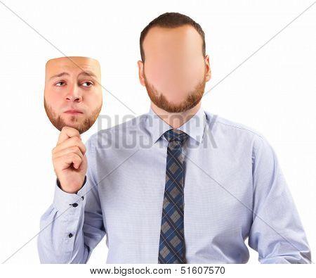 young man holding sad mask