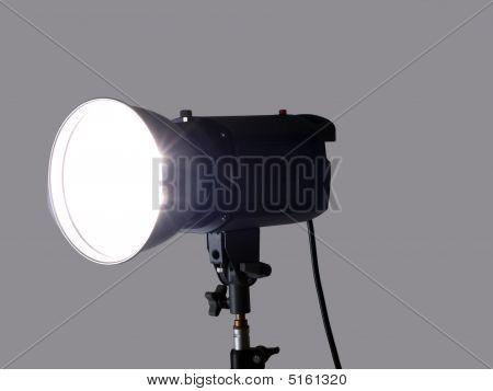 Studio Monolight Flash Unit Firing Against Gray Background