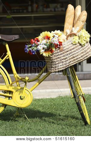 Bicycle with a basket full of bread