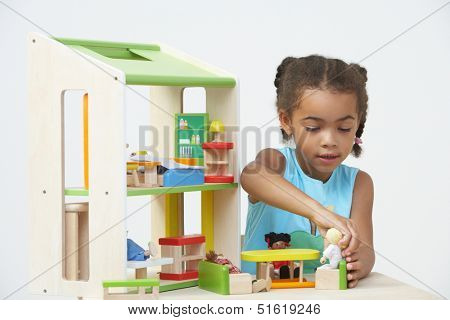 Pre-School Pupil Playing With Wooden House