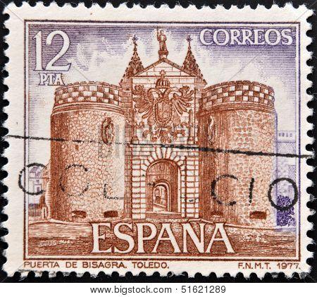A stamp printed in Spain shows facade of Bisagra door on Toledo