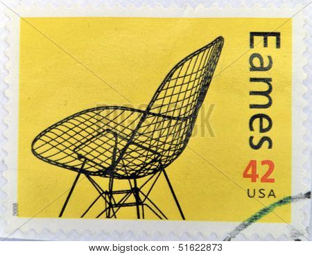 A stamp printed in USA shows eames chair
