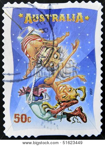A stamp printed in Australia dedicated to circus shows The Dental Trapeze
