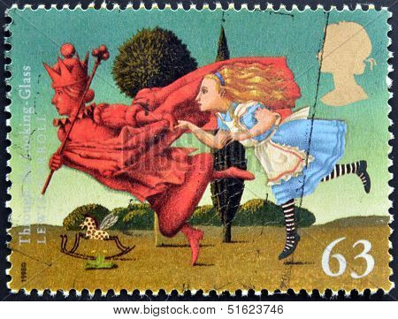 A stamp printed in Great Britain shows Through The Looking Glass (Lewis Carroll)