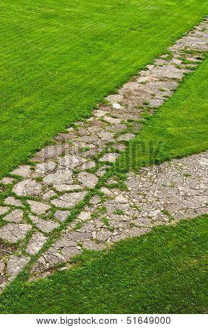 Stone Path Through A Green Lawn