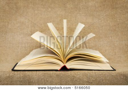 Disclosed Book On The Textile Background