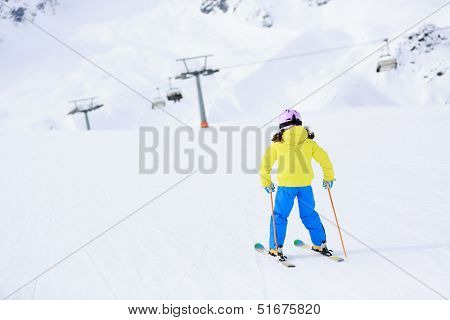 Skiing, skiers on ski run - child skiing downhill, ski lesson
