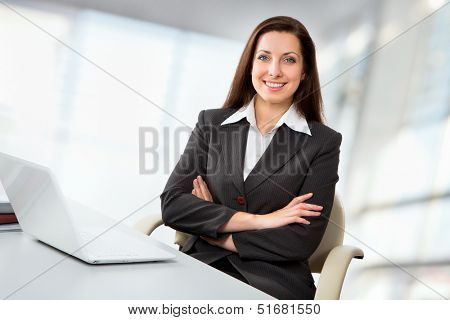 Portrait of business woman working with laptop