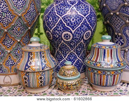 Close up of display of intricately patterned Moroccan pottery