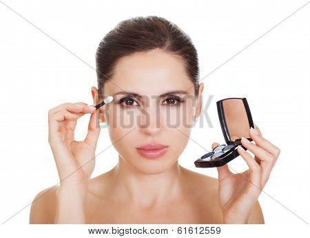 Woman Applying Eye Shadow