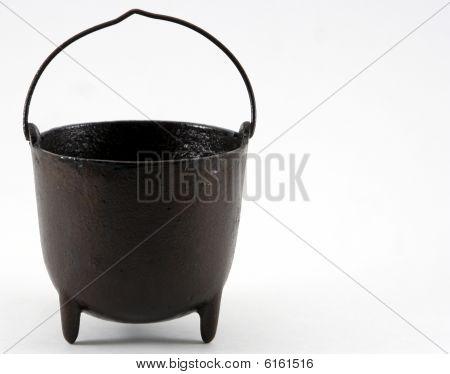 A small black cauldron