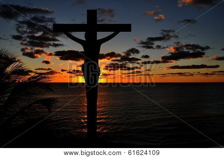 Crucifixion of Jesus Christ at Sunset Over Water