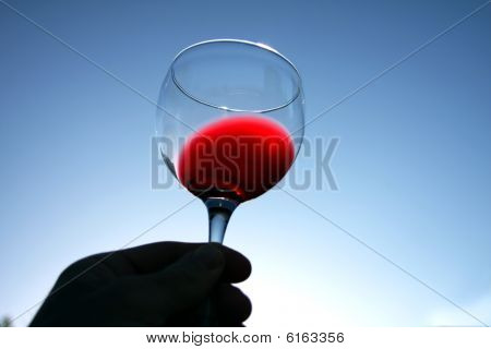 Glass Of Red Wine Over Blue