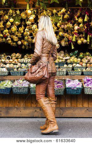 woman at Christmas market, Vienna, Austria