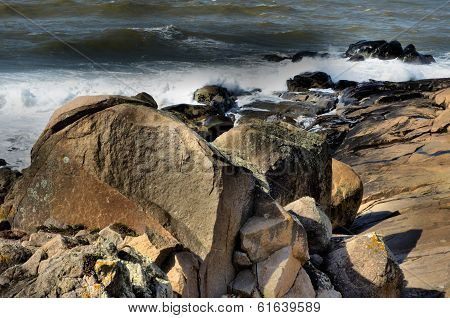 Big waves crashing against the coastal rocks