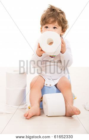Toddler Boy Sitting On Potty