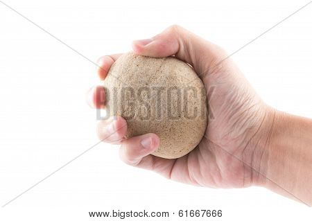 Isolated Of The Hand Is Holding To Stone In Spa On White Background