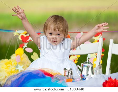 Happy Baby Girl At Festive Table