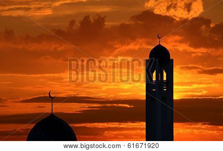 Silhouette of a mosque in sunset