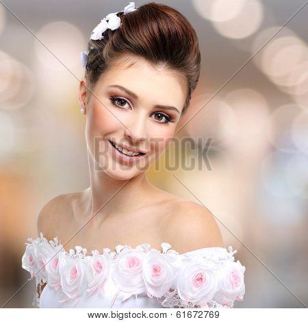 Portrait of beautiful smiling  bride in wedding dress over art background
