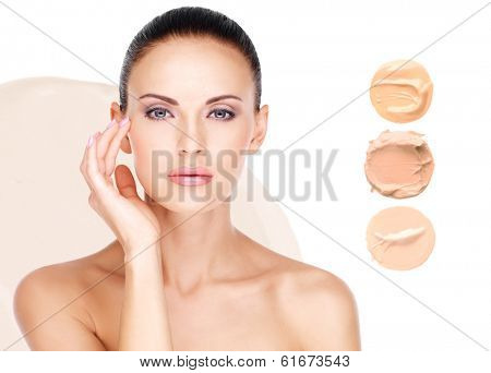 poster of Model face of beautiful woman with foundation on skin make-up cosmetics .