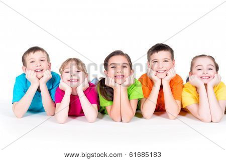 Five beautiful smiling kids lying on the floor in bright colorful t-shirts -  isolated on white.