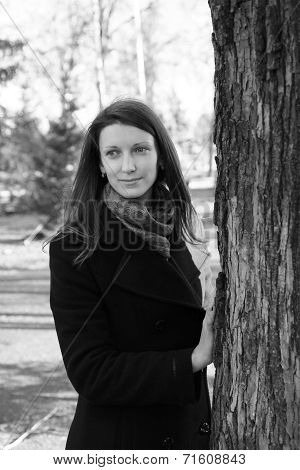 Beautiful Girl In A Park On An Autumn-day