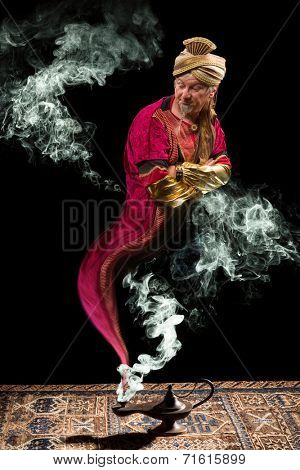 Fantasy genie with turban coming out of aladdin's oil lamp