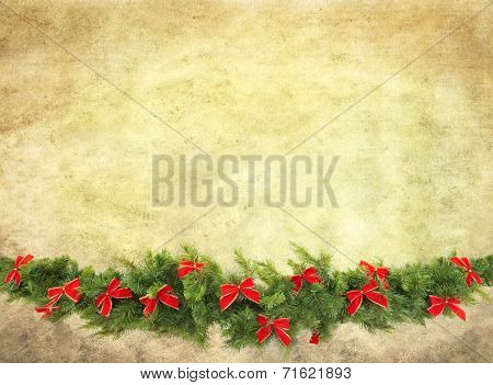 Christmas garland decorated with red velvet bows, isolated on white.