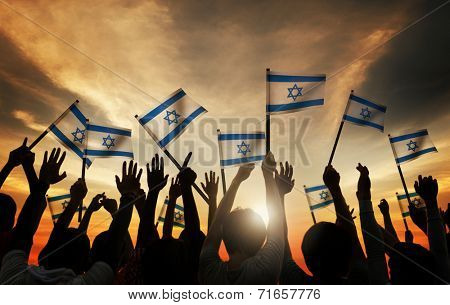Silhouettes of People Holding Flag of Israel