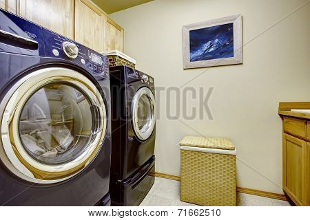 Light Laundry Room With Purple Appliances