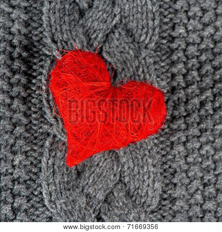 Red Heart Of Knitted Wool Background