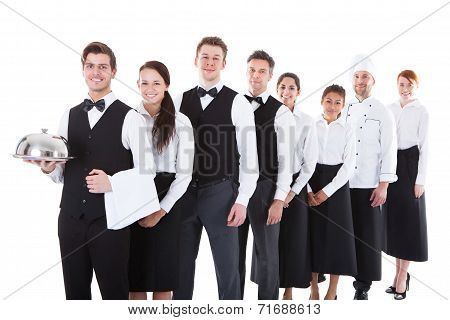 Large Group Of Waiters And Witresses Standing In Row