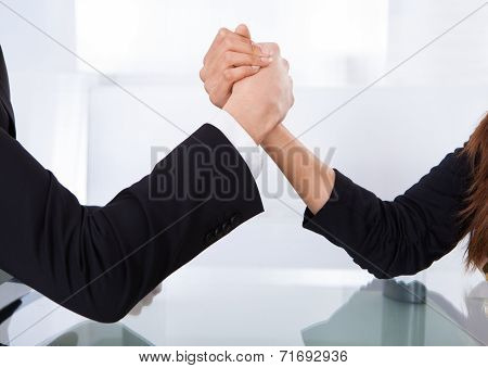 Business Colleagues Arm Wrestling